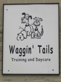 Waggin_Tails_white_sign.jpg